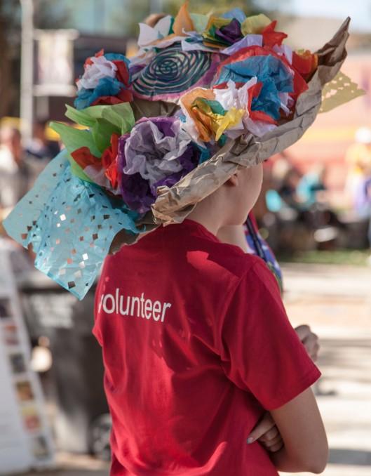 volunteer with hat